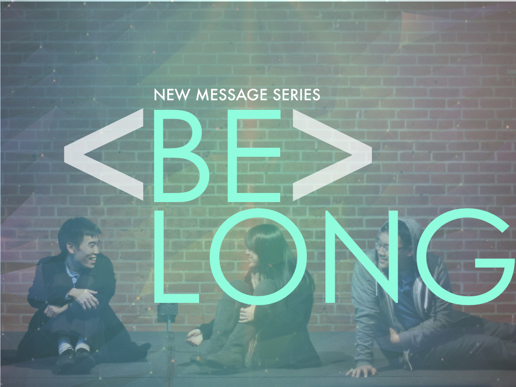 Belong Sermon Series with people against a brick wall smiling at each other